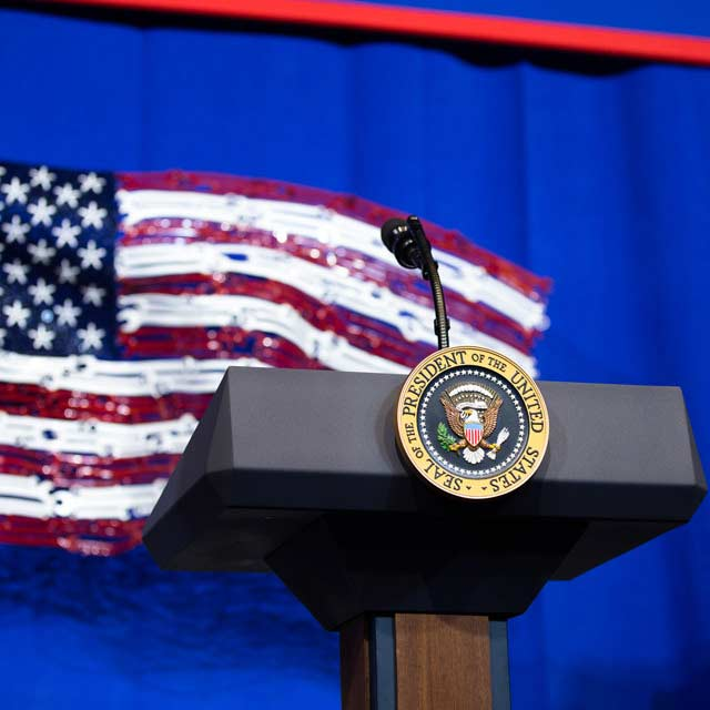 American flag made of Snap-on tools behind a Presidential podium